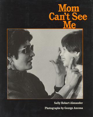 This black and white cover is a photo of me touching nine-year-old Leslie's nose and cheek with my fingers.