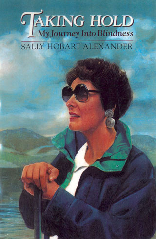 This cover is a portrait of me, hands on my cane, with a lake and mountains in the background.